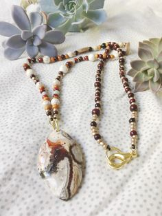 Carved Agate Beaded Necklace by AmityCircle on Etsy https://www.etsy.com/listing/534702607/carved-agate-beaded-necklace