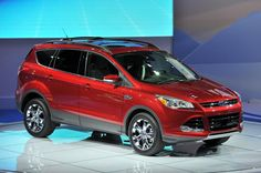 Ford Escape 2013.....not red, but some shade of a darker metallic blue, dark metallic grey, or metallic black.....this is my DREAMCAR!!!!! Want so badly ):
