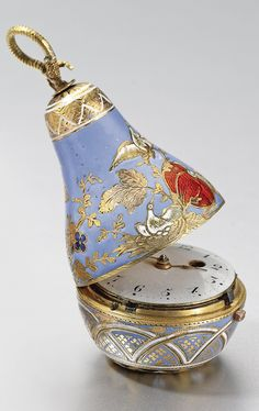 SWISS A GOLD AND ENAMEL PEAR-FORM WATCH CIRCA 1810 • gilt verge movement, balance bridge pierced with foliate sprays • white enamel dial, Arabic numerals • the case decorated with champlevé enamel in tones of white, red and green with flowers and birds over powder blue ground, the bottom with geometric enamel motif • unsigned