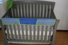 Cobalt blue and bright green crib bedding with a teething guard