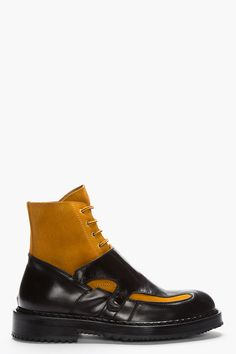 KRISVANASSCHE // Black Leather Bi-color Lace-Up Monk Hybrid Boots 32134M047001 Ankle high leather monk boots in black. Round toe. Monk style leather straps with snap button closure. Contrast suede upper in tan. Tonal lace up closure with gold tone eyelets. Black foxing. Tonal stitching. Leather upper, rubber sole. Made in Italy. $1225 CAD