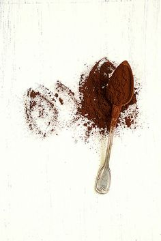 Coffee grounds in a spoon---almost looks like it's fluttering along the table trying to take off.  Perfect.