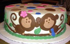 Twin boy and girl monkey baby shower cake