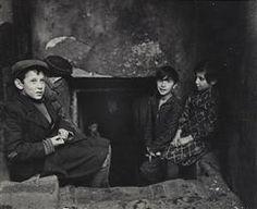 Jewish Life in Eastern Europe, ca. 1935-38 | Roman Vishniac Archive Children seeking light and air outside their basement home, Krochmalna Street, Warsaw