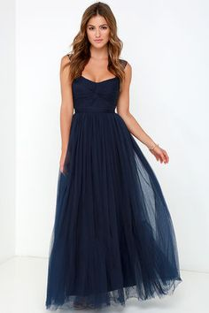 Fine and fancy, the Garden Tulle Navy Blue Maxi Dress will have heads swiveling wherever you may go! An elegant sweetheart neckline tops a knotted tulle bodice (with lightly padded cups) supported by semi-sheer shoulder straps. The tulle continues to form the banded waist, and finishes with a layered maxi skirt for a full and twirl-able look! Hidden back zipper and clasp. Fully lined. 100% Polyester. Dry Clean Only. Imported.