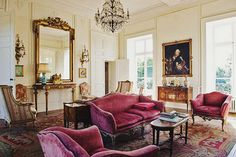 La Socelière, a chateau in the Loire Valley. The main living room is furnished with a Italian rococo sofa and armchairs, upholstered in their original purple velvet, and an French Savonnerie wool rug. A crystal chandelier hangs above. French Country Living Room, Classic Living Room, Loire Valley, Chandelier In Living Room, French Decor, Dream Decor, Fixer Upper, Decoration, Lounge