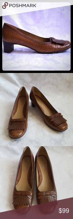 """9.5 N Chestnut Brown Croc Heel Narrow Naturalizer rich medium brown leather croc heels with 1 3/4"""" stacked wood heel. Genuine leather. Size 9 1/2 Narrow. Style is """"Dahlia"""". Brown leather fringe, trim and flat bow decorative accents.  Excellent used condition. Smoke free and pet free home.  Check out my other listings - 100's of 👠shoes👠, 👢boots👢 and 👜bags👜. Bundle 2 or more and save money!💲💵💲 Naturalizer Shoes Heels"""
