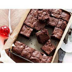 Festive chocolate brownies recipe - By Woman's Day, These decadent chocolate brownies are perfect to whip up for celebrations, whether they're wrapped up as gifts or included as part of your Christmas lunch or dinner dessert spread.