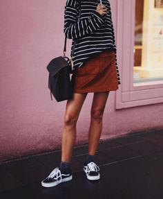andicsingerRainy days and glittery socks // @rouje skirt, #knotsisters tee via @shopbop, #vans & #mansurgavriel