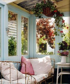 Marcee....this is what you need on your porch off the bedroom.  I love this old iron bed made into a couch