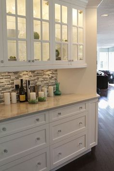 Kitchen, lighted cabinets, white on white