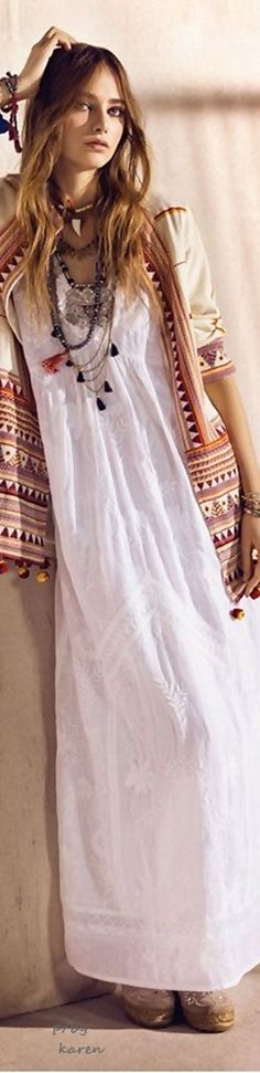 Bohemian outfit for spring: White boho maxi dress, embroidered loose jacket, layered necklaces.