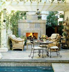 Elegant Poolside Dining                           Muted purples and gray blues of slate tiles add texture and warmth to the terrace and fireplace of this outdoor room overlooking                             a lap pool.