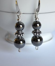 Hematite and silver dangle earrings, hematite jewelry, hematite earrings.    Hematite beads have been wrapped with sterling silver and combined with