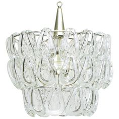Italian Mazzega Glass Chandelier With Interlocking Tiers. | From a unique collection of antique and modern chandeliers and pendants  at http://www.1stdibs.com/furniture/lighting/chandeliers-pendant-lights/