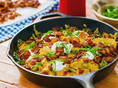 Get Grilled Cheesy Loaded Potatoes Recipe from Food Network