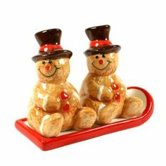 """Gingerbread Tabletop Salt & Pepper Shaker With Tray Set by TII Collections. $9.95. Food Safe - 3-Piece Salt & Pepper Shaker set.. Glossy finish ceramic construction.. A perfect Christmas decoration.. Each shaker measures 2.5"""" x 2"""" x 2"""". Tray measures 4.5"""" long.. Gingerbread Tabletop Salt & Pepper Shaker With Tray Set. Food Safe - 3-Piece Salt & Pepper Shaker set. Glossy finish ceramic construction. Each shaker measures 2.5"""" x 2"""" x 2"""". Tray measures 4.5"""" long. A perfect Christmas..."""
