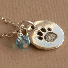 Pet Lovers Mommy Necklace, Paw Print Hand Stamped On Sterling Silver, Your Choice of Birthstone Color Crystal, Dog Lovers, Cat Lovers. $29.00, via Etsy.