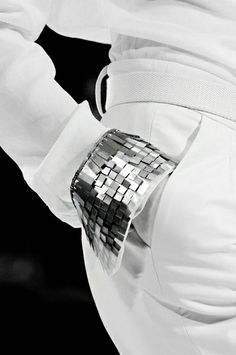 White shirt sleeve cuff detail with layered tab textures - embellished fashion details
