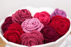 Bowl of roses. Pattern here http://pompomemporium.com/content/crocheted-flowers-roses