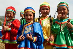Kids in traditional dress in the Altai mountains.
