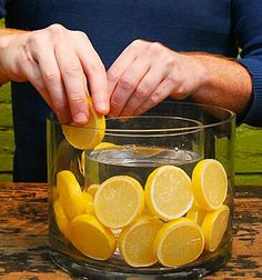 Easy and simple table decoration of a vase within a vase with sliced lemons in between. Place another vase inside, between the lemons and the outer vase. Dollar Tree vase and a half gallon mason jar! Table Centerpieces, Wedding Centerpieces, Table Decorations, Summer Centerpieces, Fruit Centerpiece Ideas, Lime Centerpiece, Orange Centerpieces, Dollar Tree Centerpieces, Graduation Centerpiece