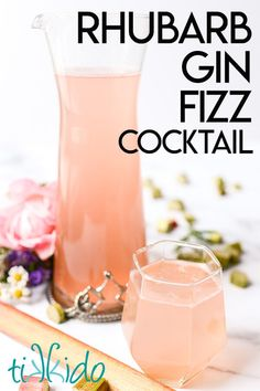 This rhubarb gin fizz cocktail is perfect for summer!  Made with rhubarb simple syrup, gin, and prosecco (or ginger ale), it's gorgeous AND delicious! Rhubarb Gin Cocktail, Gin And Prosecco, Rhubarb And Ginger Gin, Gin Fizz Cocktail, Cocktail Drinks, Ginger Ale, Cocktail Recipes, Dinner Recipes, Smoothie Recipes