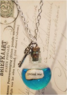 Iridescent Alice in Wonderland 'drink me' necklace  by amarese, $14.95