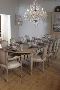 French inspired dining room, limed oak chairs, crystal chandelier