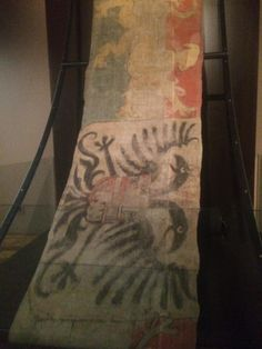 Extant 16th century Spanish banner. It is described as the Pennant flagship at the Battle of Lepanto Ca 1571. It is about 14 times as long as it is wide and is noted as being oil on linen. Only painted on one side with a seam running along it. (Photo: A West)