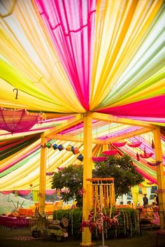 Mehendi function decor with bright Colourful Draps umbrella and scooter Indian Wedding Theme, Bengali Wedding, Indian Wedding Photos, Wedding Stage, India Wedding, Wedding Entrance, Entrance Decor, Wedding Hall Decorations, Marriage Decoration