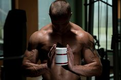 Body builder Posing With Supplements For Copy Space