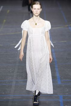 John Galliano - A demi-leg-of-mutton sleeve provides a throwback touch for prim brides-to-be.