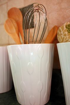 I use these in my craft space ... from IKEA and are flower pots ... great size and cool patterns