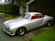 Silver Ghia with Red Interior. Not so much a luxury car... But oh so cool and a real head turner!