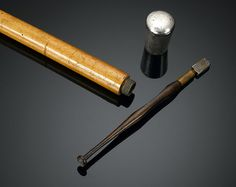 """This rare burglar's cane is equipped with a glass cutter for discreet, and most importantly, keyless entry. The silver knob unscrews to reveal the burglar's tool within the solid wood shaft.<br><br>Hallmarked London, 1901<br><br>36 1/2"""" length"""