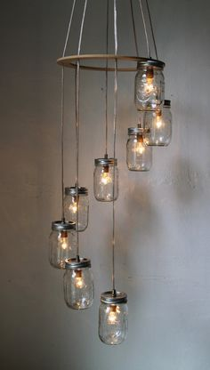 Mason jar light good for a stairway fixture...Wonderfully charming, sweetly creative hanging light fixture made with old canning jars.
