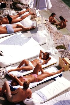 Sunbathers at Hôtel du Cap Eden Roc on the French Riviera by Slim Aarons, 1969.