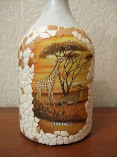 How to decoupage egg shells in glass bottle? Here you can see the illustrated work step by step with Liquor Bottle Crafts, Wine Bottle Art, Plastic Bottle Crafts, Painted Wine Bottles, Diy Bottle, Vodka Bottle, Eggshell Mosaic, Wine Bottle Centerpieces, Bottle Decorations