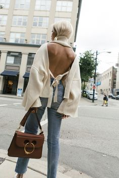 $585 Coltrane Malea Organic Backless With Bow Tie Cotton SweaterTeamed With $1,690 J.W. Anderson Pierce Medium Leather Shoulder Bag And Light Wash Denim Jeans Tumblr