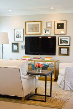 Hang some pictures around the tv in our room to make it seem more planned and appealing