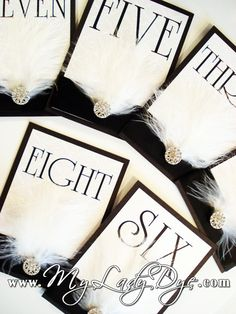 Vintage Feather Table Card With Crystal Embellishment. $14.49, via Etsy.