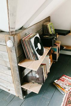 stacks of vinyl records on a reclaimed wood shelf in the attic of table on ten, an inn in bloomville, upstate new york. #everydaymadewell