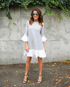 Reminisce on the 90's in our adorable Clueless Sweater Dress! This heather grey long sleeve sweater has a cute white ruffle bell sleeve contrast and a ruffle hem line on the bottom. We love the contra