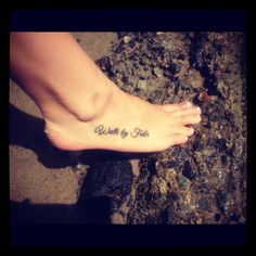 Walk by faith foot tattoo.