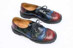 What a great looking pair of John Fluevog shoes. Low cut lace ups with deep dark shades of burgundy, blue and green. Chunky Dr. Martens