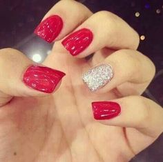 Red nails with the ring finger   Silver sparkles