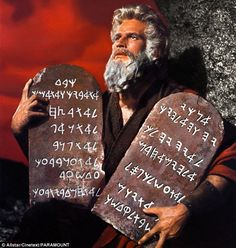 Charlton Heston in The Ten Commandments holding the tablets of the covenant