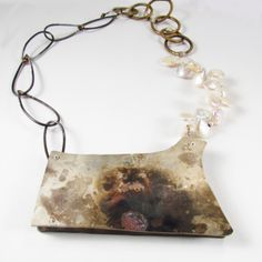 Necklace+of+re+purposed+silver+plate+with+fire+patina.+Riveted+to+found+pexi-glass,+with+steel,+brass+and+fresh+water+pearls.+About+18+inches,+and+main+element+is+3+1/2+by+2+inches.+