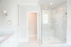 Beautiful marble bathroom with walk-in shower. Nice design and layout. Almost looks like Benjamin Moore Moonshine as the paint colour #marble #bathroomdesign